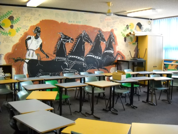 Mural on classroom wall depicting a Roman behind four prancing horses