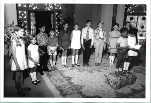 Children standing inside the Sydney Baha'i Temple.
