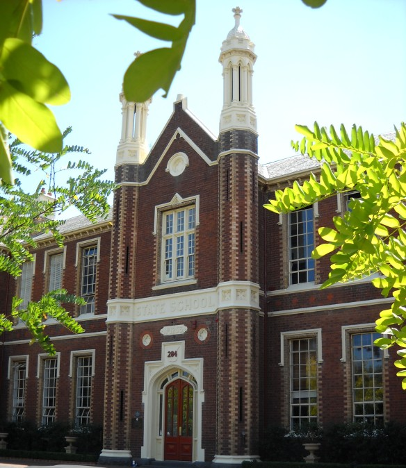 Photo of front of two story red brick school building