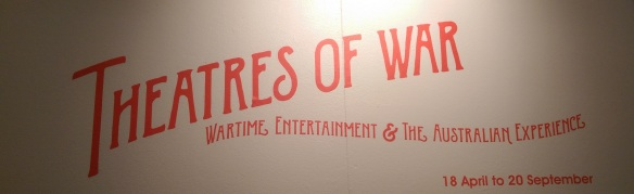 Banner of the title of the exhibition on the wall at the entrance to the exhibition.