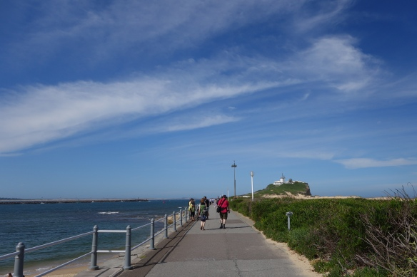 Walking along the breakwater at the entrance to the Newcastle Harbour.